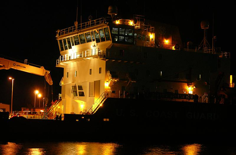 Coast Guard Cutter Mackinaw at night in the Cheboygan RIver
