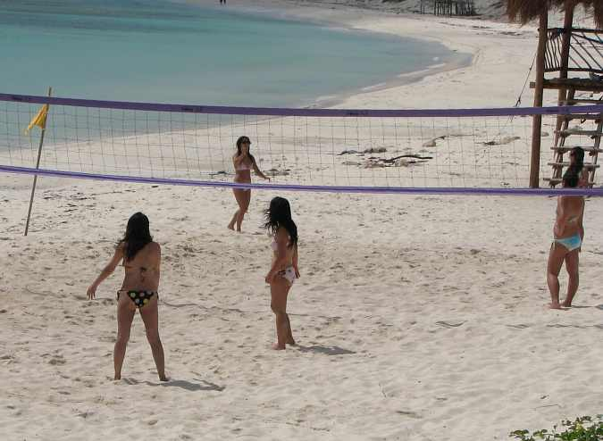 beautiful girls playing vollyball on the beach at Cozumel