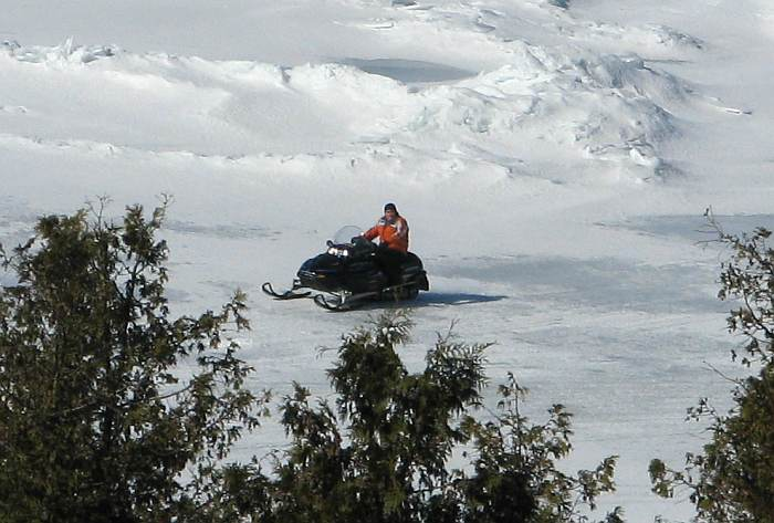 Snowmobile on ice in the Straits of Mackinac.