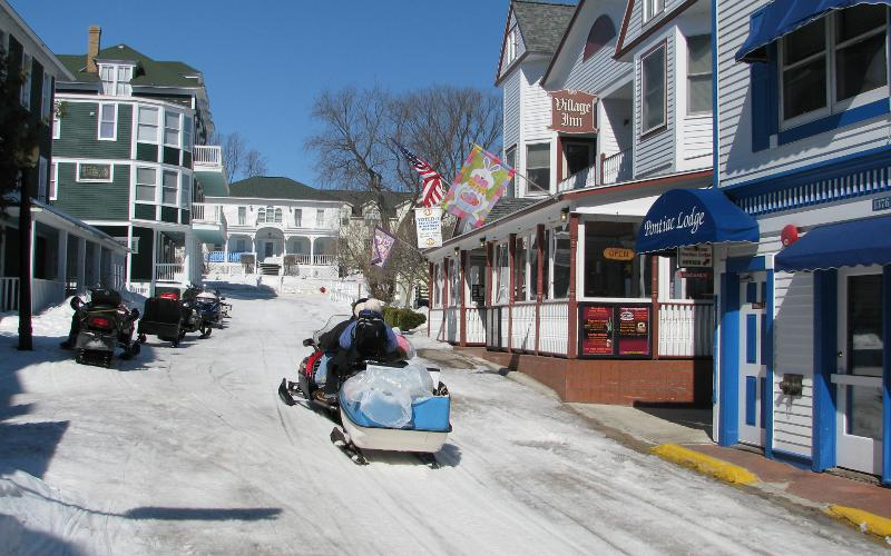 Snowmobiling on Mackinac Island streets