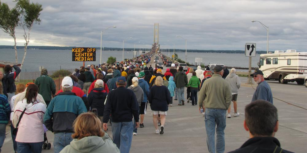 Walkers at the foot of the Mackinac Bridge in Michigan