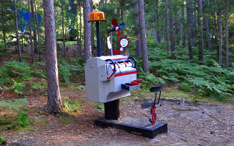 slot machine sculpture in the woods