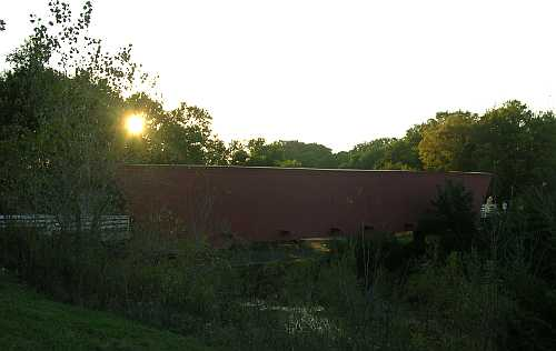 Sun settnig behind Hallowell Covered Bridge